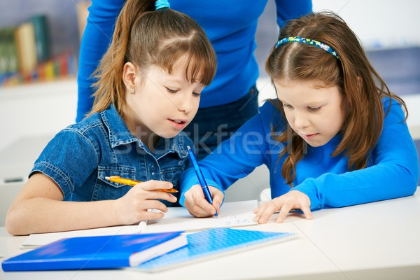 Schoolgirls learning in classroom Stock photo © nyul
