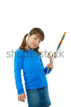 Lány nyalóka mosolyog iskolás lány pózol néz Stock fotó © nyul