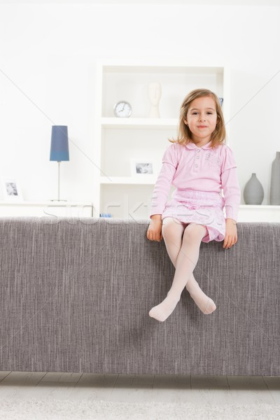 Girl in pink sitting on couch Stock photo © nyul