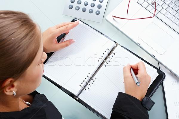 Businesswoman writing Stock photo © nyul
