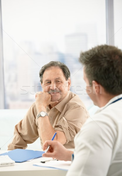 Smiling patient at doctor's office Stock photo © nyul