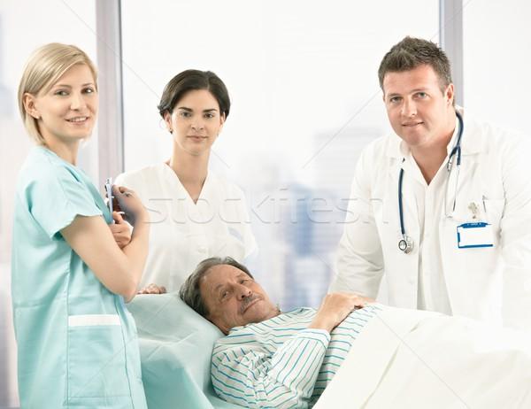 Portrait of senior patient with hospital crew Stock photo © nyul