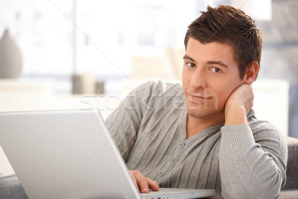 Portrait of handsome young man with computer Stock photo © nyul