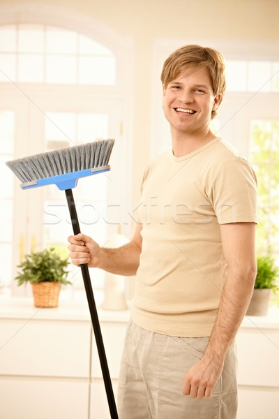 Happy guy with broomstick Stock photo © nyul