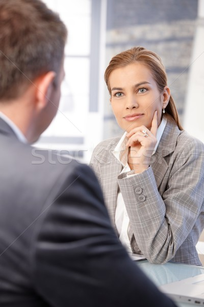 Businesswoman interviewing male applicant Stock photo © nyul