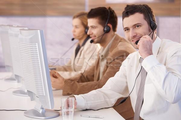 Cheerful customer servicer working in call center Stock photo © nyul