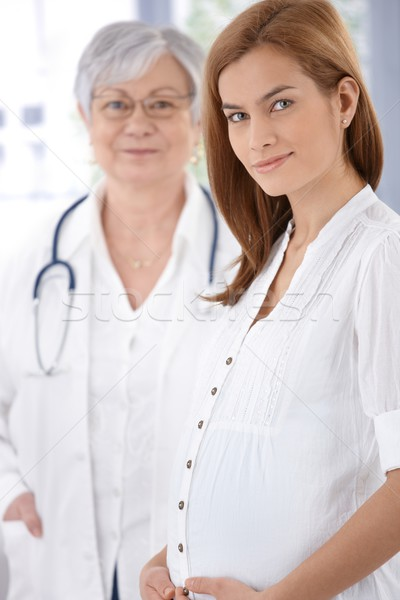 Portrait of pregnant mother and doctor Stock photo © nyul