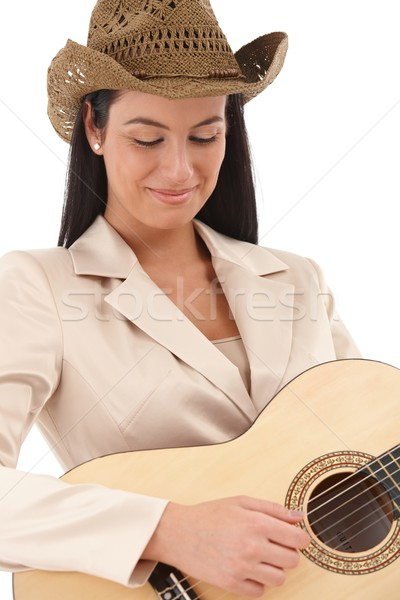 Female guitar player lost in music smiling Stock photo © nyul