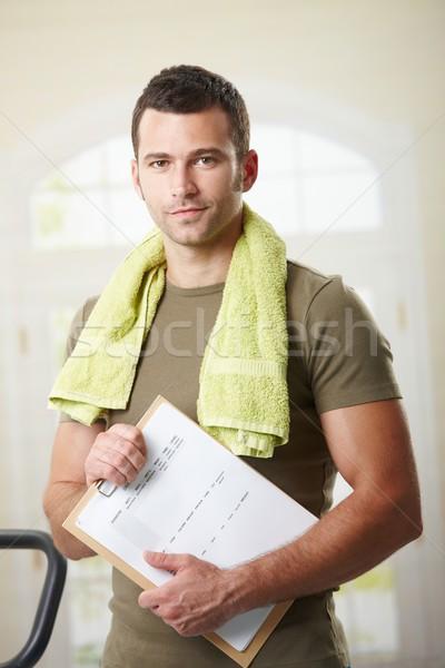 Man holding training plan Stock photo © nyul