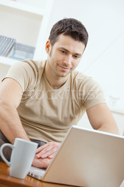 Happy man using computer Stock photo © nyul