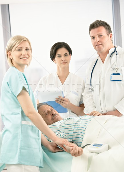 Portrait of medical team with patient Stock photo © nyul
