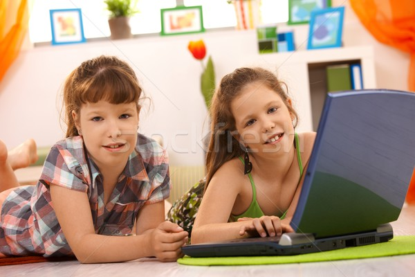 Little girls playing on computer at home Stock photo © nyul