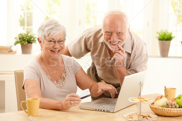 Portrait of happy old couple shopping online Stock photo © nyul