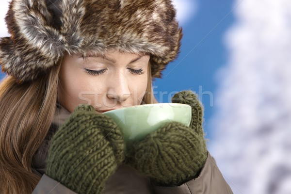 Stock photo: Young female dressed up warm enjoying hot tea