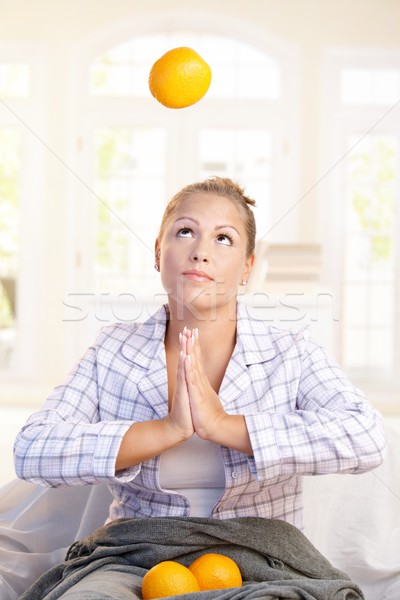 Pretty girl juggling with grapefruits in bed Stock photo © nyul
