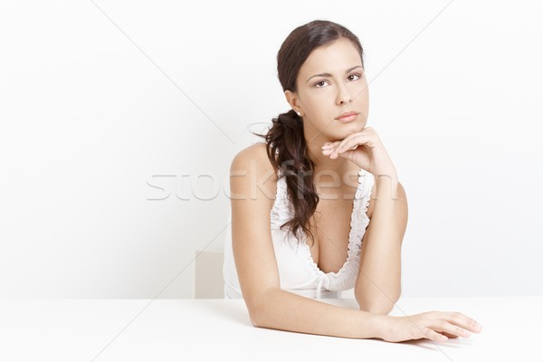 Portrait of troubled woman over white background Stock photo © nyul