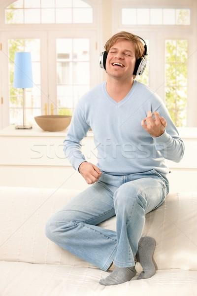 Young man enjoying music Stock photo © nyul