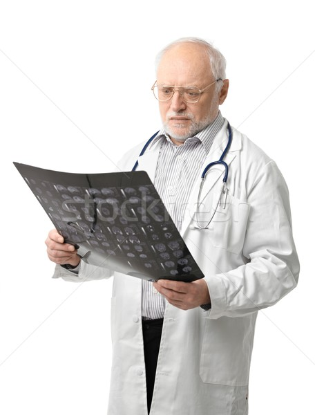 Portrait of senior doctor looking at X-ray image Stock photo © nyul