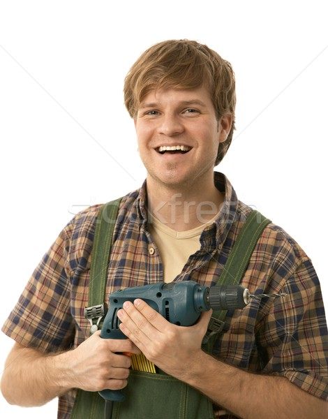 Young handyman holding power drill Stock photo © nyul