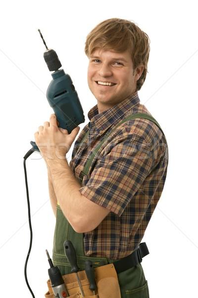 Happy handyman posing with power drill Stock photo © nyul