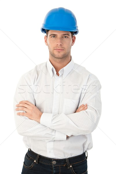 Goodlooking young architect standing arms crossed Stock photo © nyul