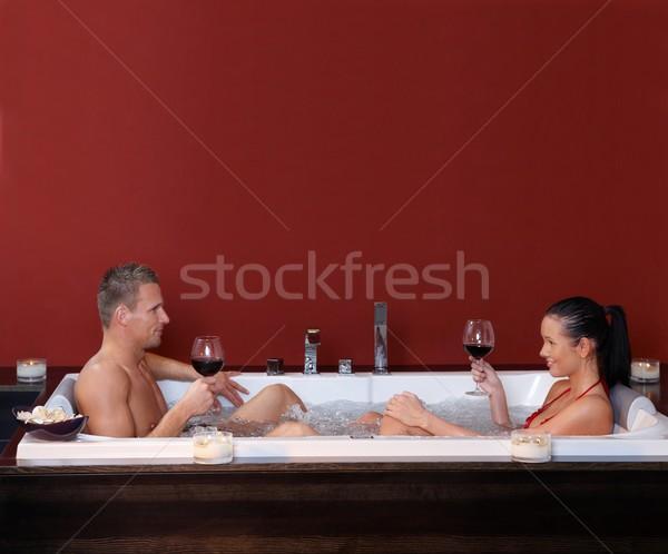 счастливым пару сидят джакузи вместе питьевой Сток-фото © nyul