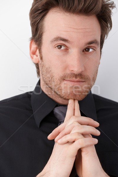 Stock photo: Young man thinking.