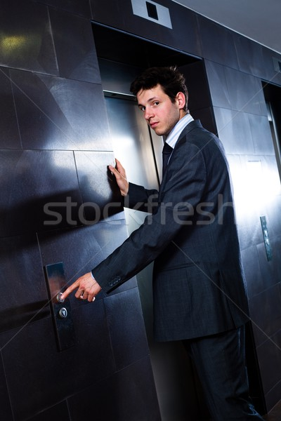 Businessman calling elevator Stock photo © nyul