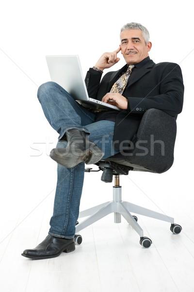 Stok fotoğraf: Işadamı · çalışma · dizüstü · bilgisayar · mutlu · olgun · oturma
