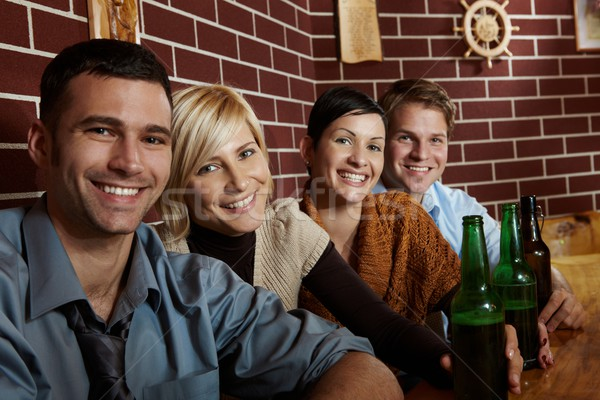 Portrait of happy young people in pub Stock photo © nyul