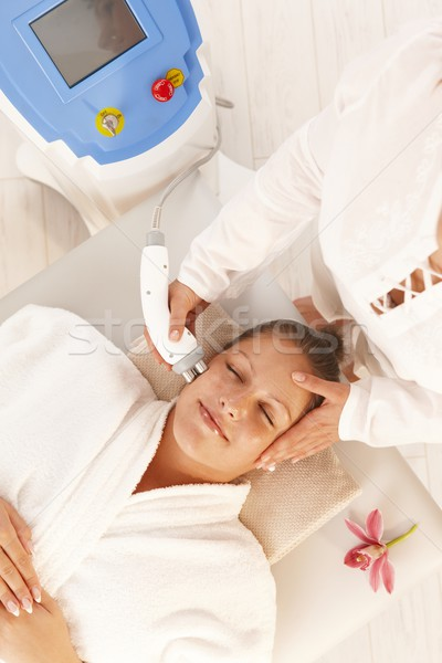 Woman getting radio frequency treatment Stock photo © nyul