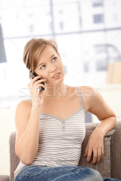 Stock photo: Attractive woman talking on mobile at home