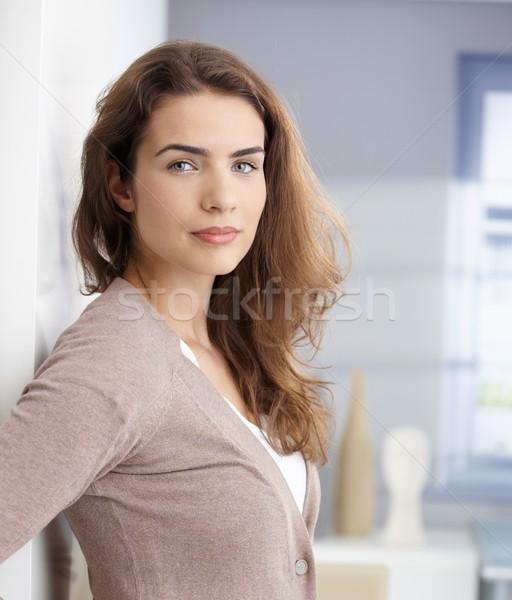 Beautiful girl standing at wall Stock photo © nyul