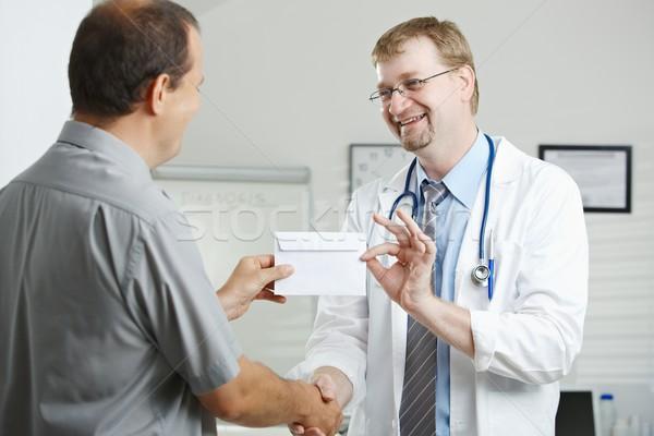 Patiënt arts medische kantoor geld envelop Stockfoto © nyul