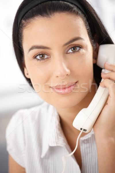 Attractive woman with landline phone Stock photo © nyul