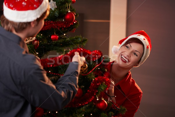 Stock photo: Happy couple decorating christmas tree
