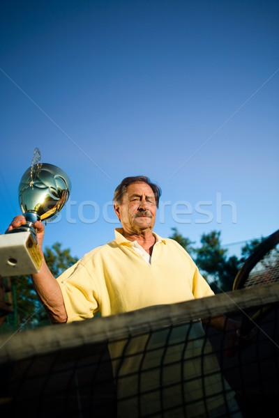 Aktif kıdemli adam 70s poz tenis kortu Stok fotoğraf © nyul
