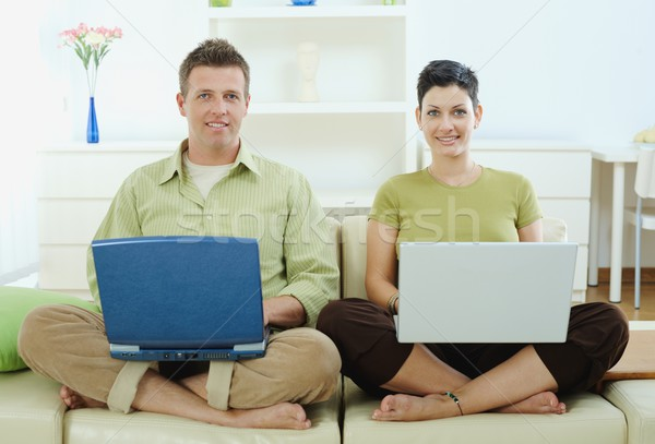 Happy couple using computer Stock photo © nyul