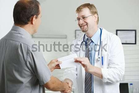 Stock fotó: Orvos · ül · asztal · nővér · megvizsgál · beteg