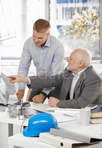 Stock photo: Senior and junior designers in office