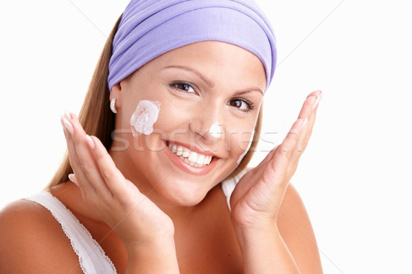 Stock photo: Portrait of attractive woman cleaning face smiling