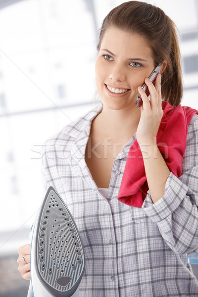 Stockfoto: Gelukkig · vrouw · telefoon · oproep · strijken · ijzer