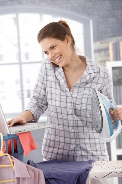 Laughing modern woman multitasking Stock photo © nyul