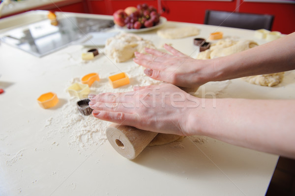 Closeup of woman hand with rolling baking cookies Stock photo © O_Lypa