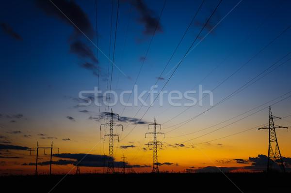 силуэта высокое напряжение драматический красочный небе Сток-фото © O_Lypa