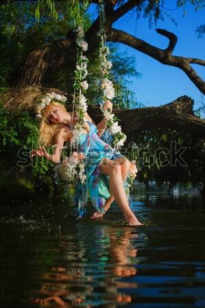 Donna swing fiume ragazza albero Foto d'archivio © O_Lypa
