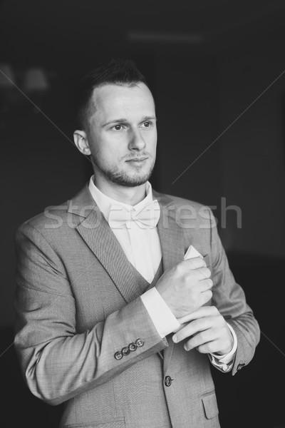 Young man dressing up for wedding celebration. Stock photo © O_Lypa