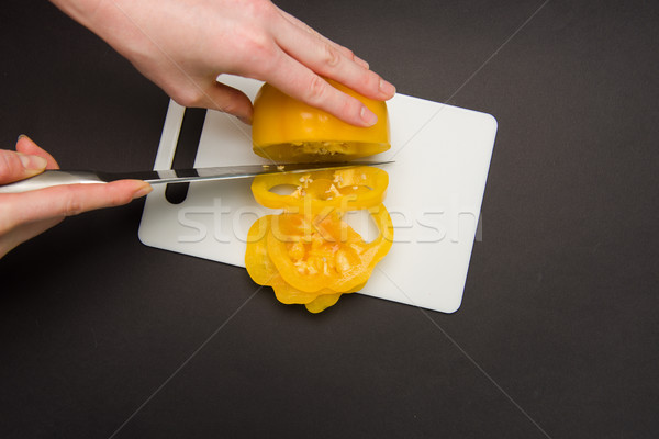 Top view of slicing yellow pepper Stock photo © O_Lypa
