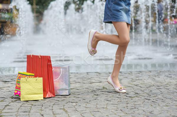 Stock photo: Girl joyful jumps on one leg