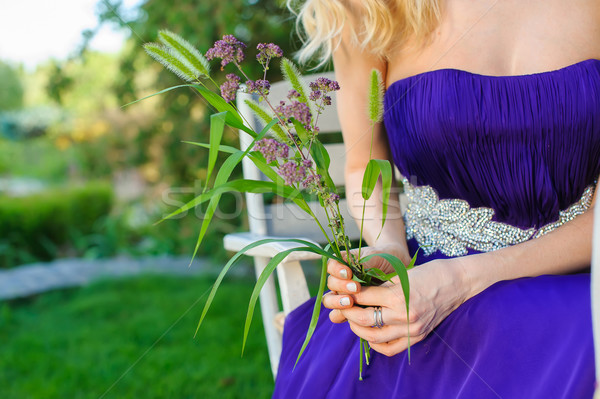 Woman holding bouquet of wildflowers. Stock photo © O_Lypa